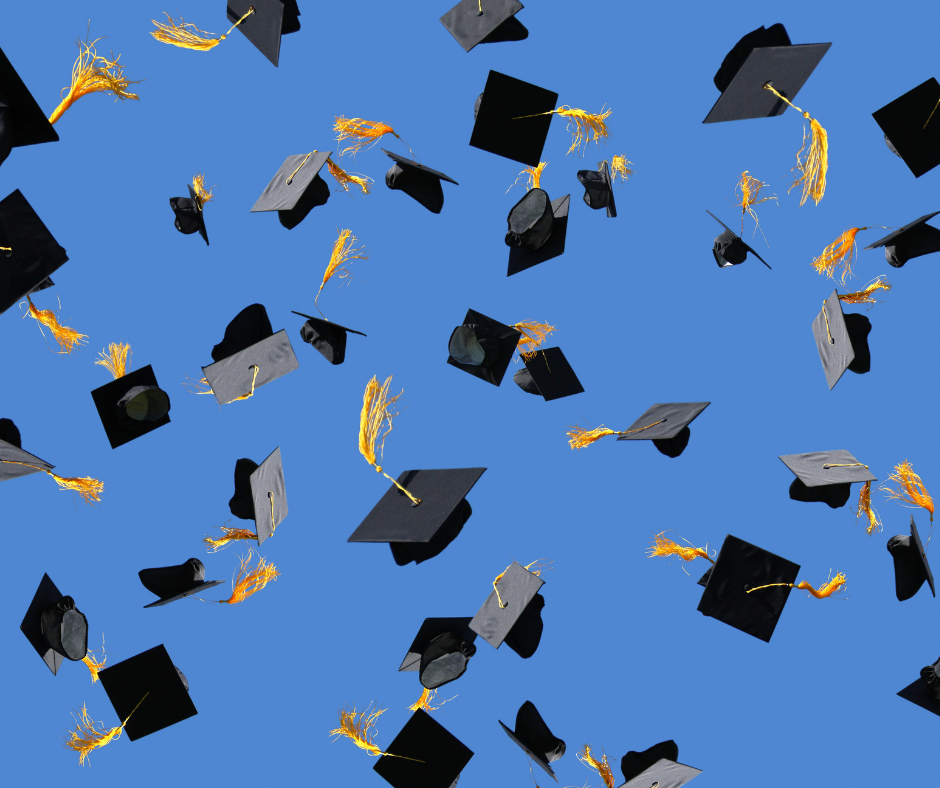 photo of graduation hats in the air