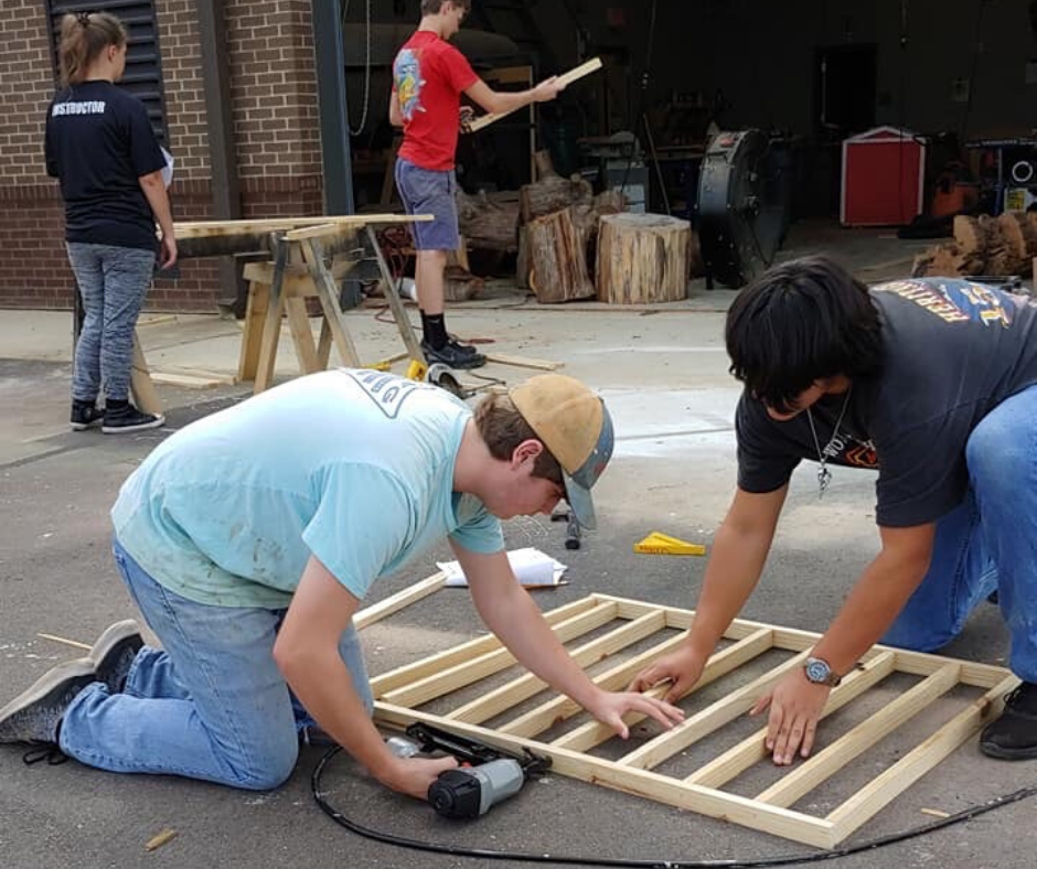 Students work in carpentry class.