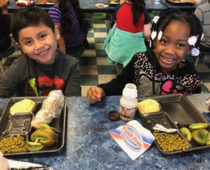 Students eating in a TCSS cafeteria.