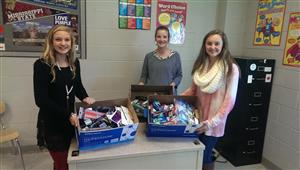 Sigma Members show off items that we collected for Tuscaloosa's Hope Buckets.