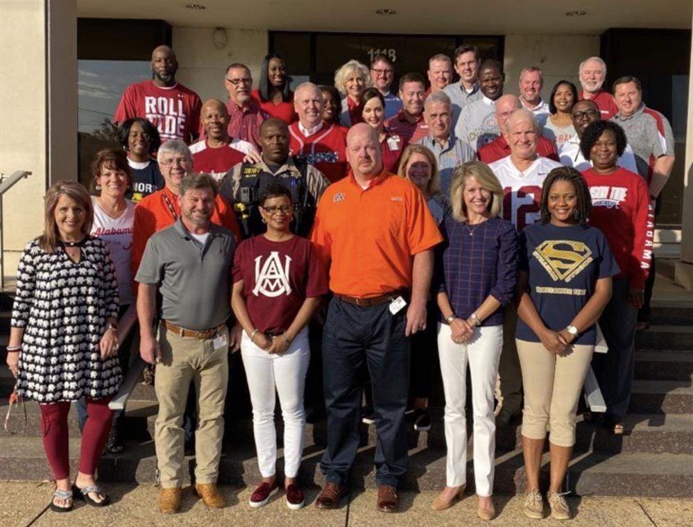 TCSS administrators dressed in team colors.