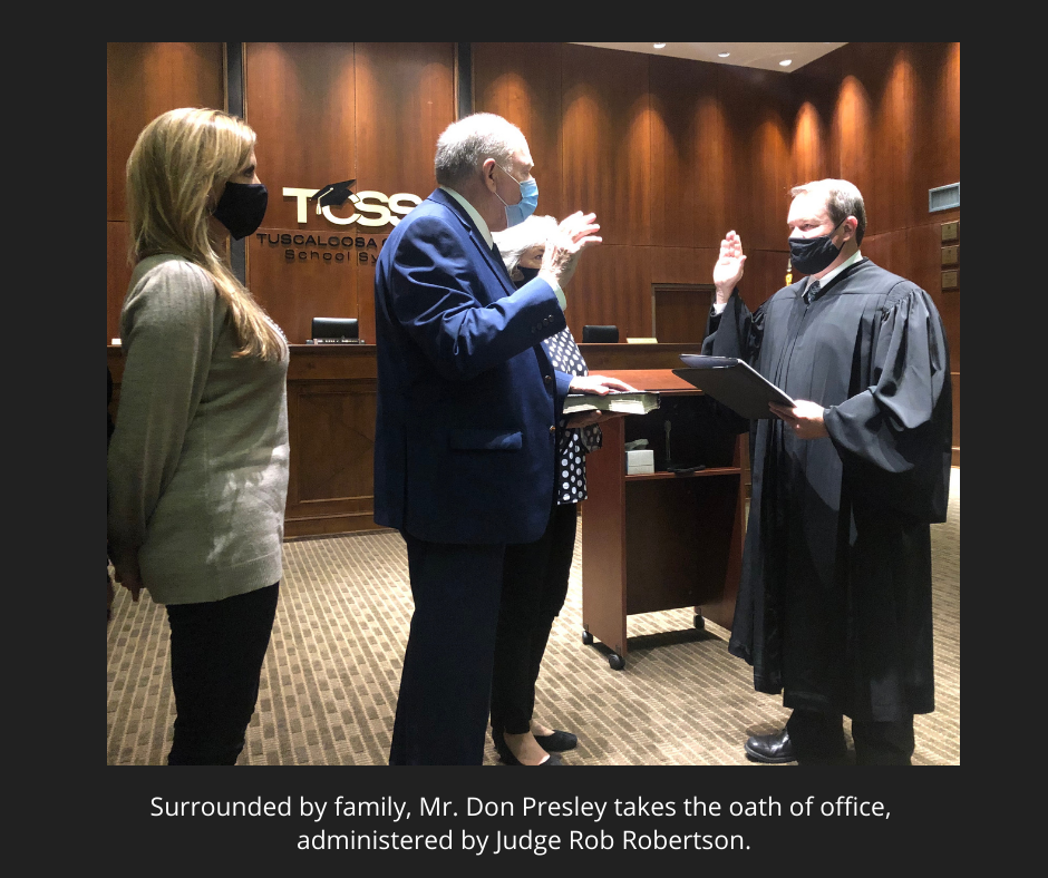 photo of Mr. Presley taking oath of office, surrounded by family. Oath administered by Judge Rob Robertson.