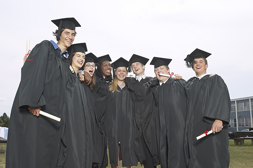 a group of graduates in caps and gowns